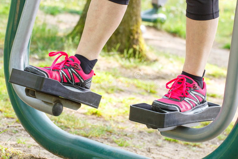Legs of elderly senior woman on outdoor gym, healthy lifestyle royalty free stock images