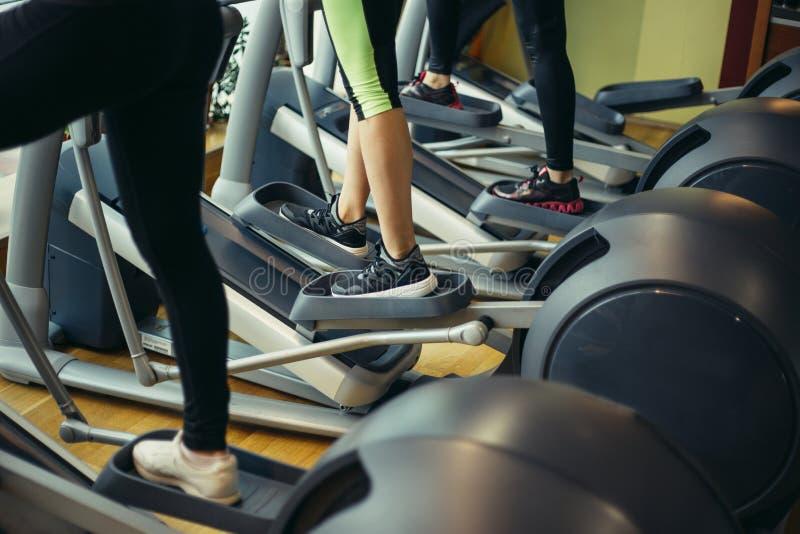 Legs on elliptical trainer royalty free stock photo