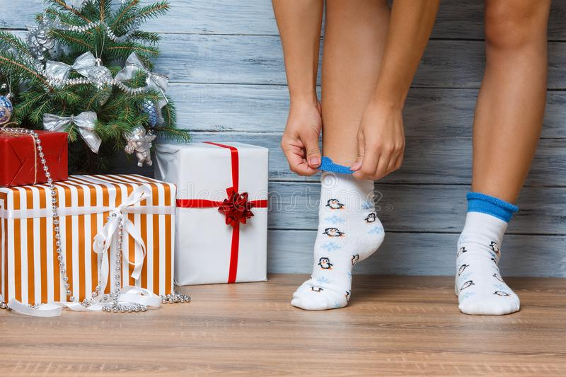 Legs of a girl who wears socks with a print. Close-up. royalty free stock photography