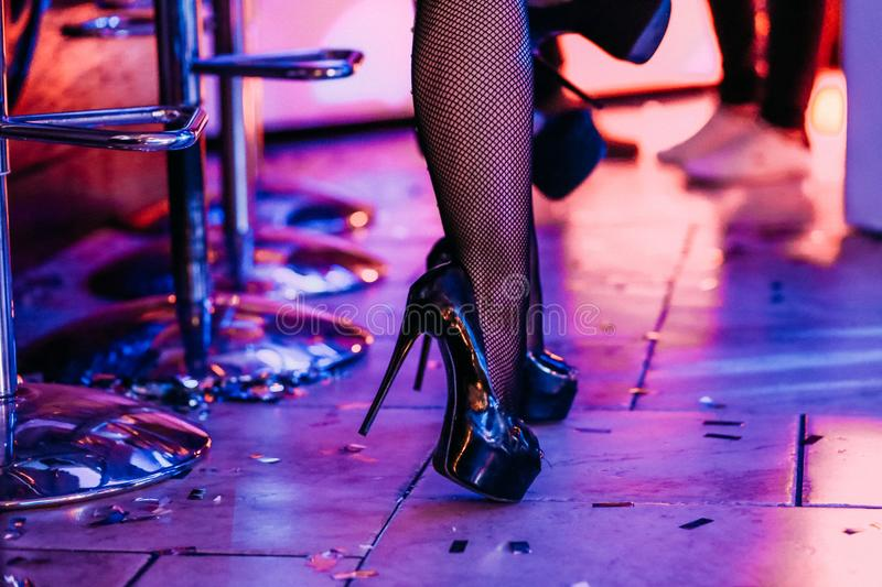 Legs female dancer high heeled shoes bar counter royalty free stock photo