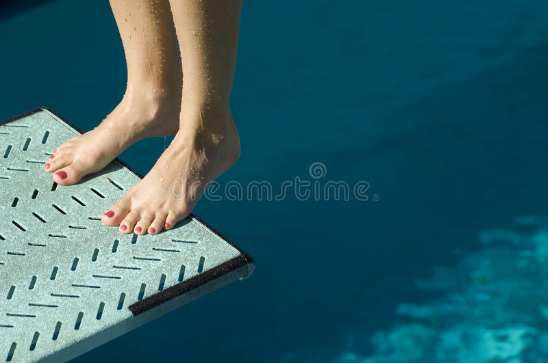 Legs Of Female At The Edge Of The Springboard royalty free stock photos