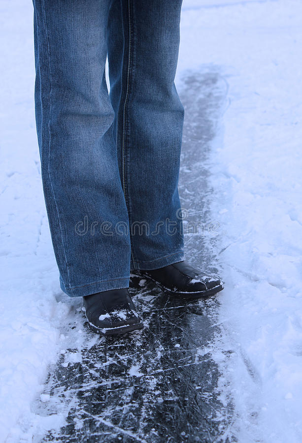 Download Winter Background - Legs Of Girl On The Ice Royalty Free Stock Photography - Image: 25438927