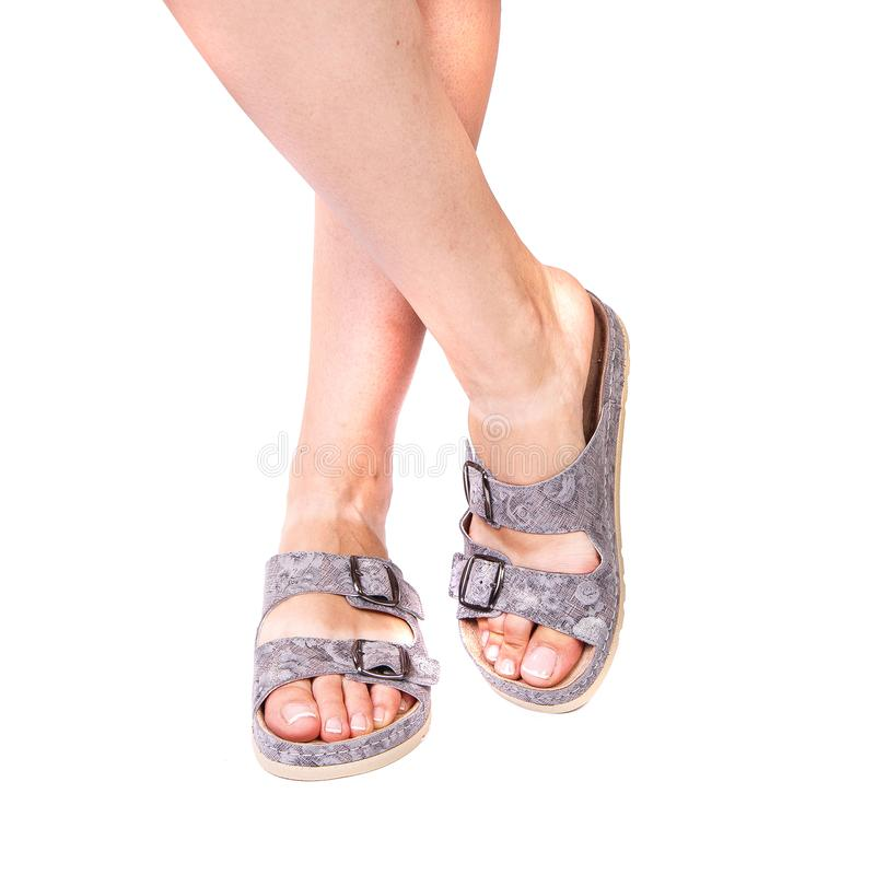 Legs of a girl orthopedic shoes on white isolated background royalty free stock photography