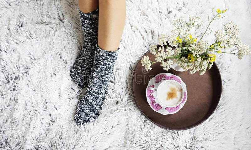 Legs of girl in warm woolen socks stock images