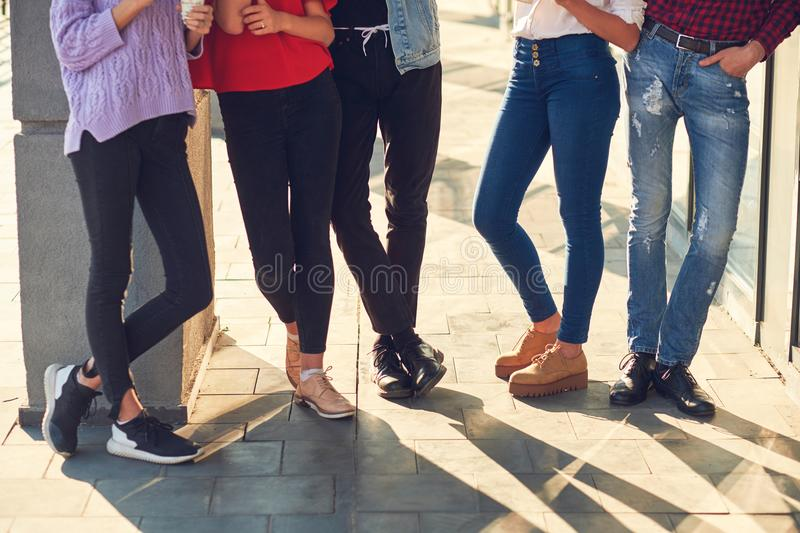 Legs of group of casual young people royalty free stock image