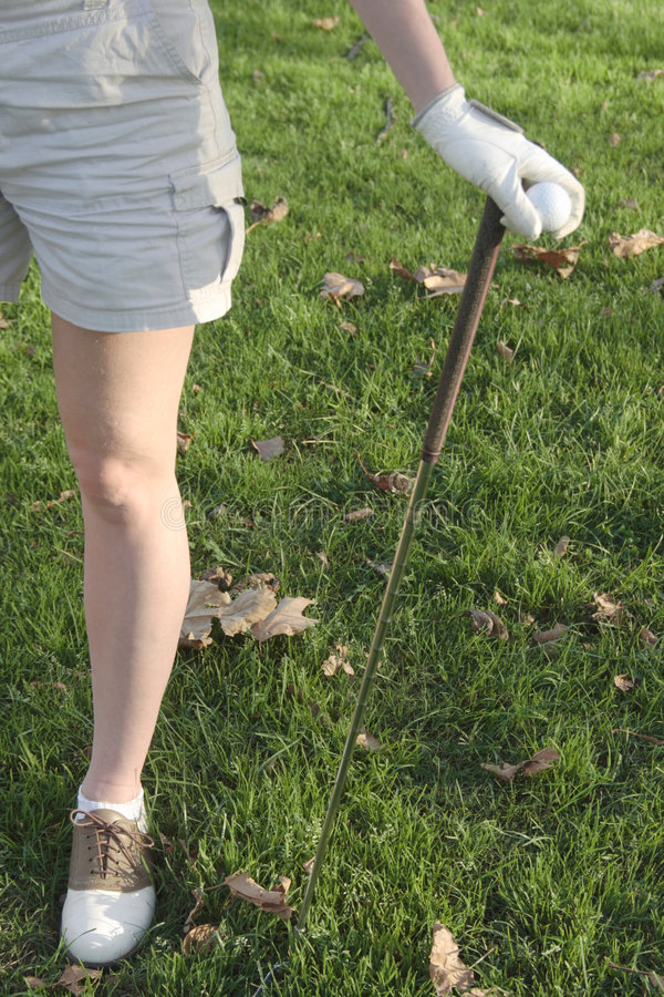 Legs of Lady golfer royalty free stock photo