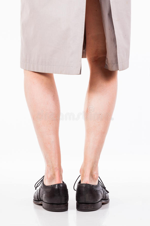 Legs of man in raincoat. Getting ready for a visit to the park royalty free stock photography