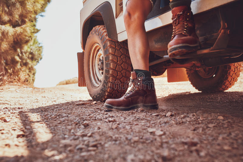 Legs of a man sitting on a off road vehicle. royalty free stock image