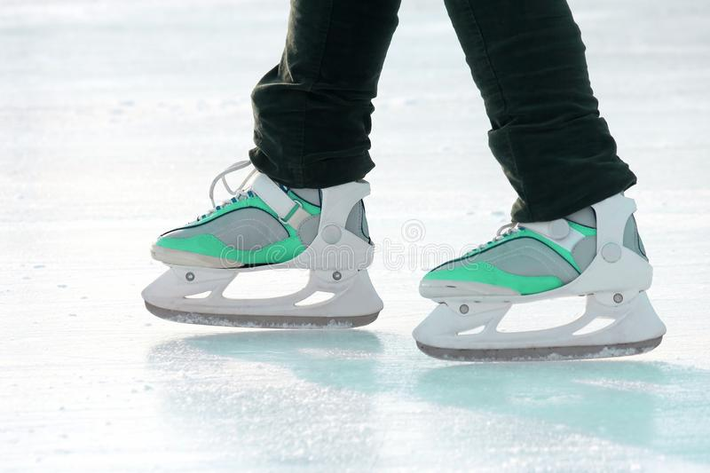 Legs of a man skating on the ice rink. sports, Hobbies and recreation of active people. The legs of a man skating on the ice rink. sports, Hobbies and recreation royalty free stock images