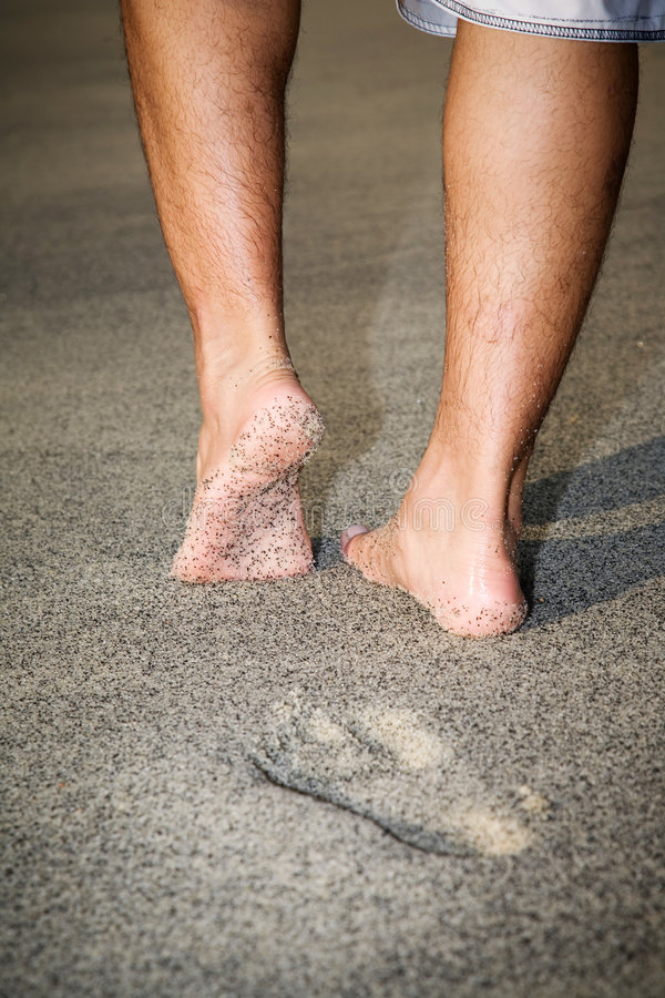 Download Legs Of A Man Walking On The Beach Stock Image - Image: 4862399