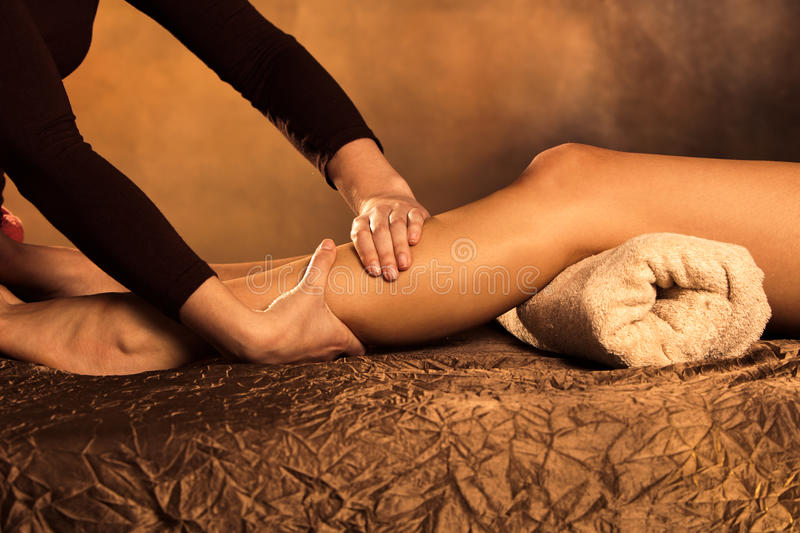 Legs massage stock images