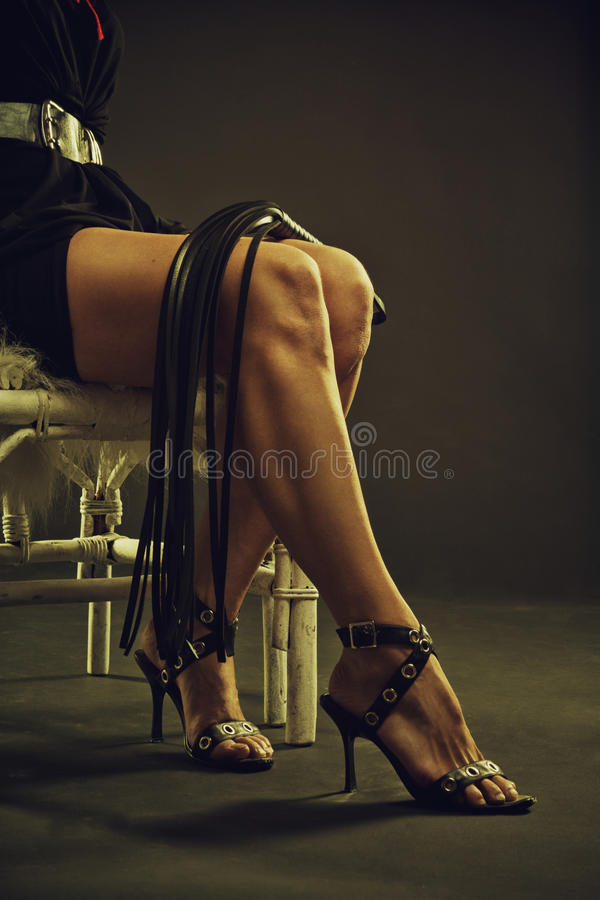 Legs of a mistress royalty free stock photography