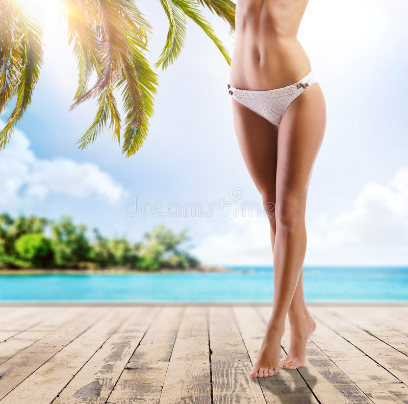 Free Legs Of A Young Woman On The Beach Royalty Free Stock Image - 70730546