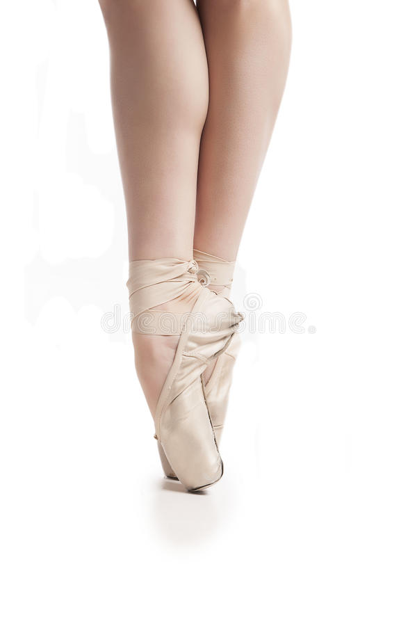Legs in pointe ballerina on white background royalty free stock photos