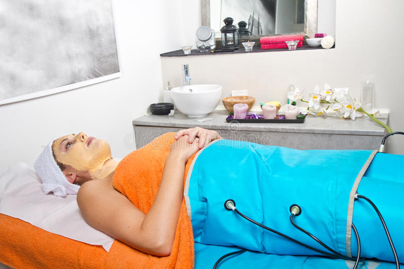 Legs pressotherapy machine on woman in beauty center stock photo