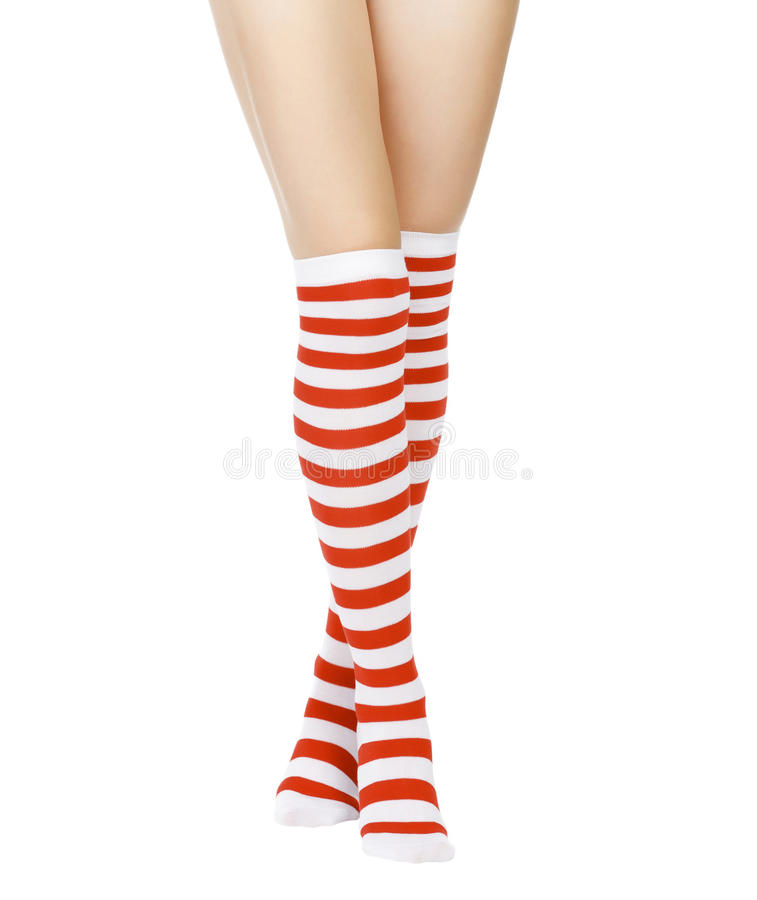 Legs in red and white socks stock photo