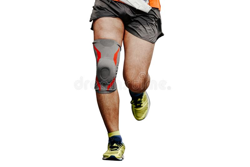 Legs runner man in knee pads. Running isolated in white background royalty free stock photography