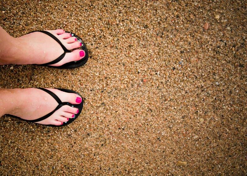 Legs on sandy beach. Slim girl's legs on sandy beach stock photography