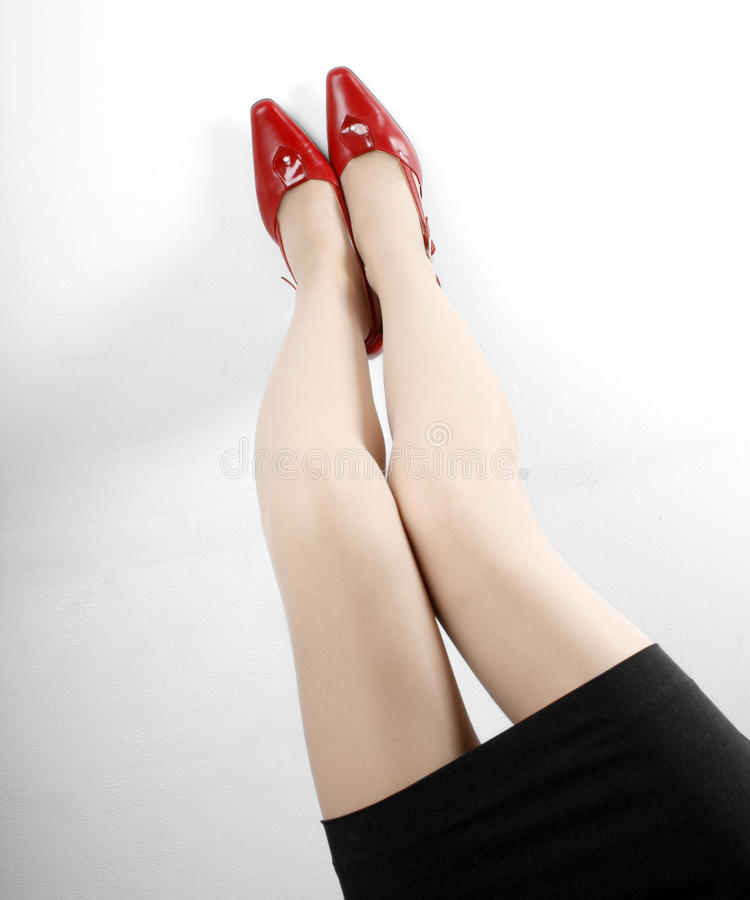 Legs and shoes. Beautiful legs and red high heels shoes royalty free stock image