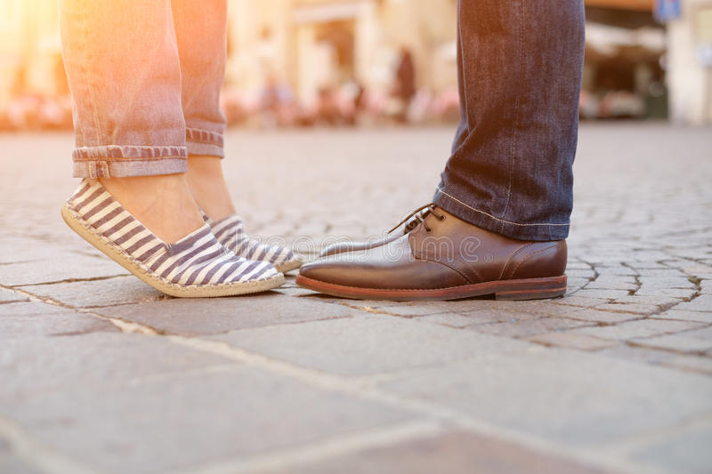 Legs and shoes of a couple in love. Legs and shoes of a couple royalty free stock photos
