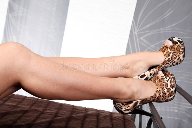 Legs with shoes from tiger pattern royalty free stock images