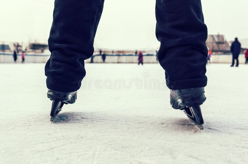 Legs of skater in motion at skating rink stock photography