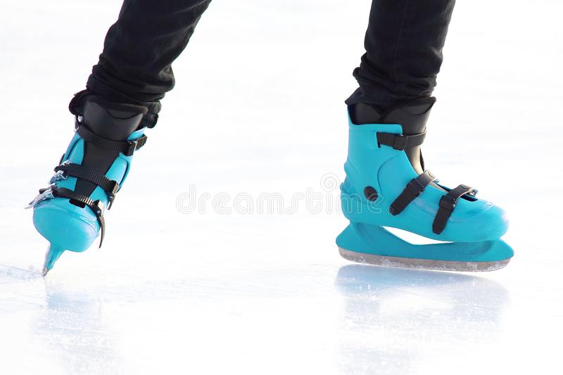Legs in skating on the ice rink. sports, Hobbies and recreation of active people. The legs in skating on the ice rink. sports, Hobbies and recreation of active royalty free stock photography