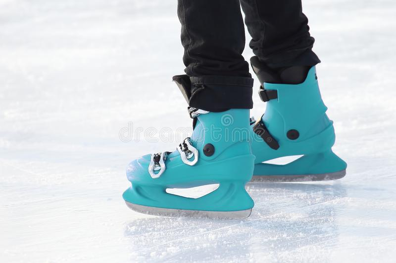 Legs in skating on the ice rink. sports, Hobbies and recreation of active people. The legs in skating on the ice rink. sports, Hobbies and recreation of active stock photo
