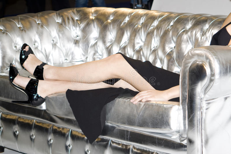 Legs on sofa royalty free stock photo