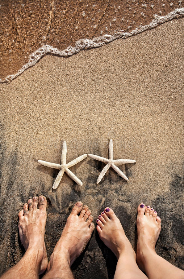 Download Legs and starfishes stock photo. Image of lover, couple - 27772060