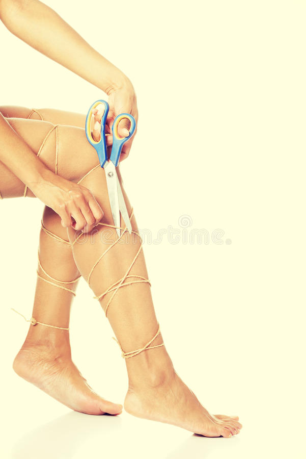 Legs tied with rope. Legs pain concept - legs tied with rope royalty free stock image