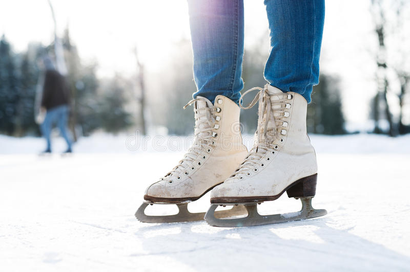 Legs of unrecognizable woman ice skating outdoors, close up. stock image