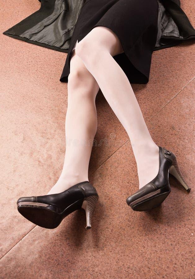Legs of the victim. Crime scene imitation stock image