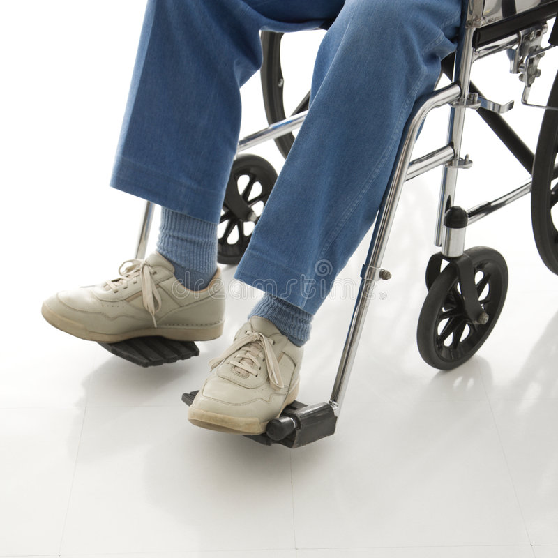 Legs in a wheelchair. royalty free stock photography
