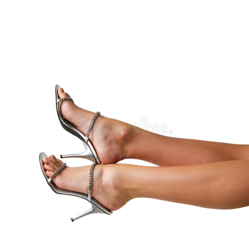 Legs of a woman. With bright sandals royalty free stock image
