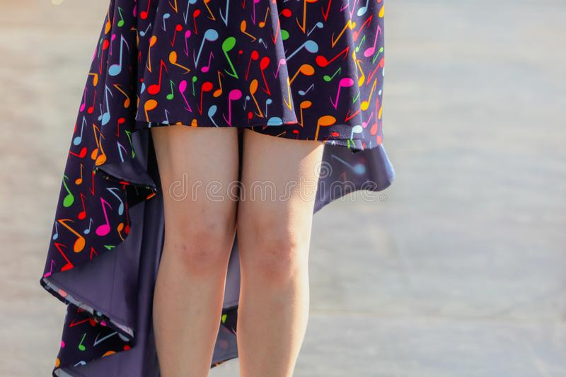Legs of a woman in a dress royalty free stock photography