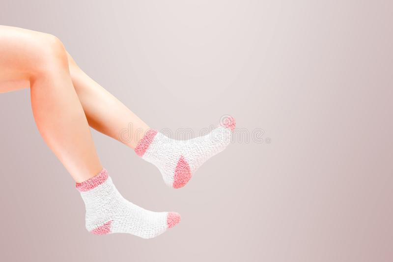 Legs of woman with fashion socks on background. Wearing winter socks. stock image