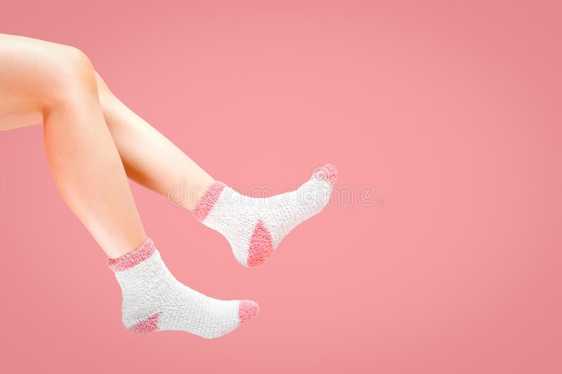 Legs of woman with fashion socks on pink background. Wearing winter socks stock images