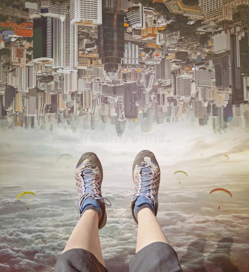 Legs of a woman in sneakers relaxing in sky. royalty free stock photo