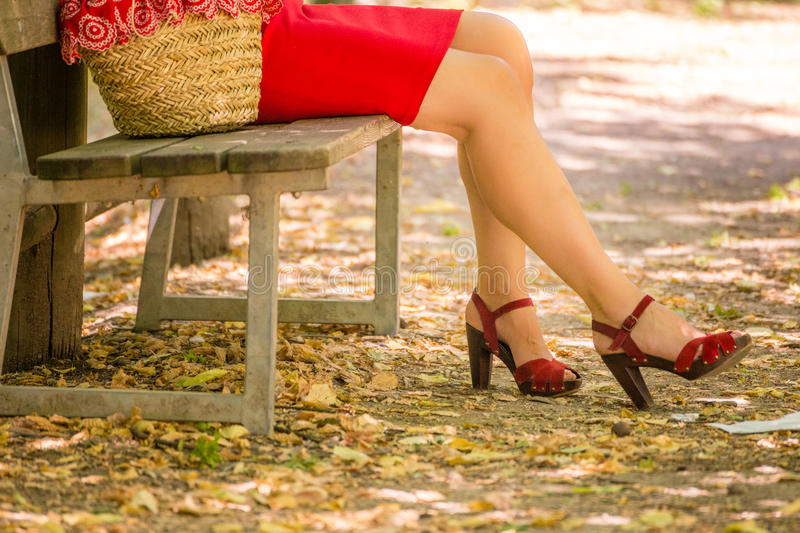 legs of woman waiting on a bench royalty free stock photography
