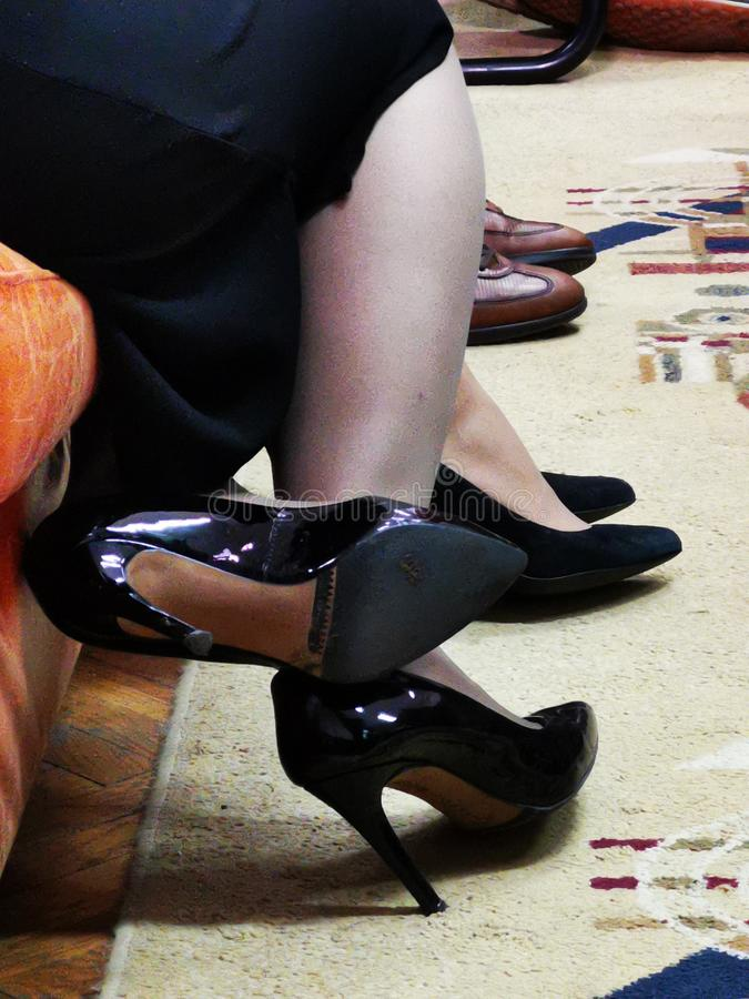 Legs of women - black heels royalty free stock image