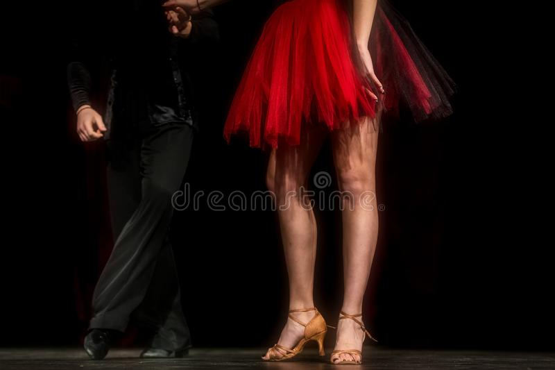 Legs of young dancers on the dance floor stock photos
