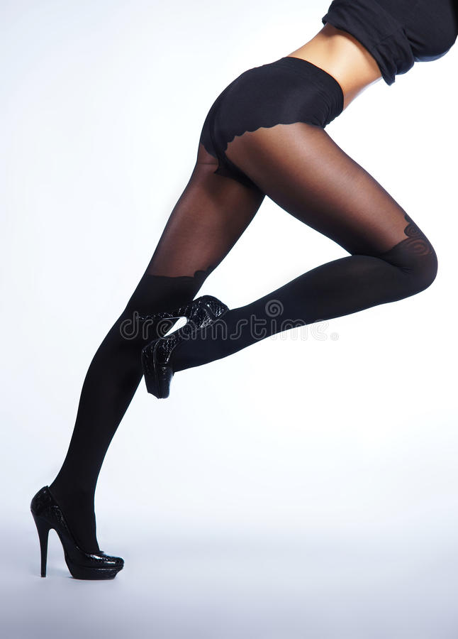 Download Legs Of A Young And Fit Woman In Black Stockings Stock Photo - Image: 27817980