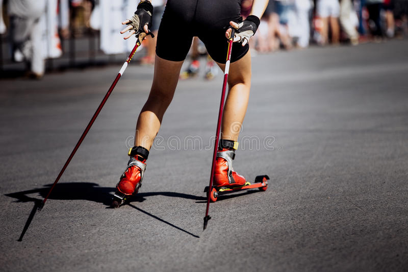 Legs young girl athlete in ski-roller stock photography