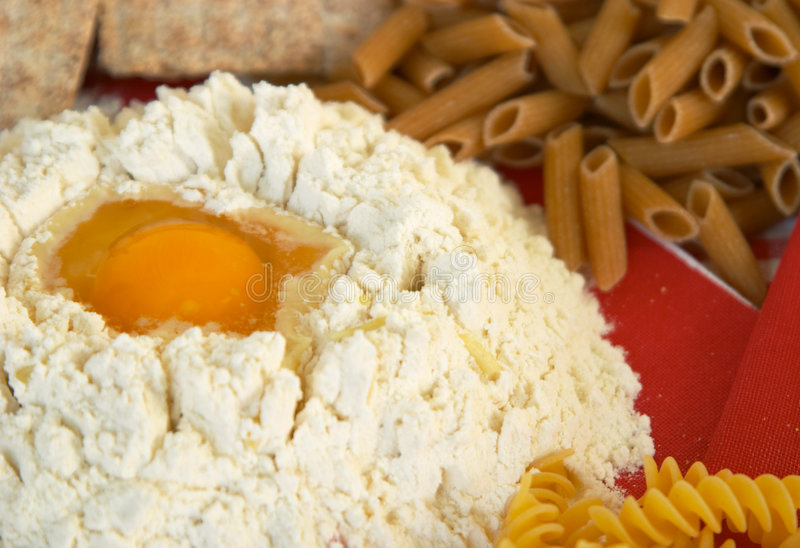 Legumes, cereals, pasta, rice, bread, egg, flour, biscuits, corn polenta royalty free stock images