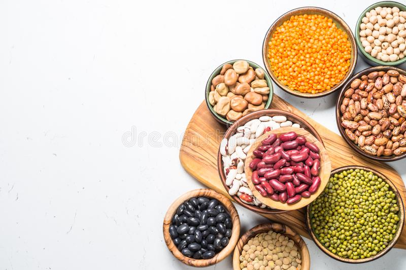 Legumes, lentils, chikpea and beans assortment on white. stock image