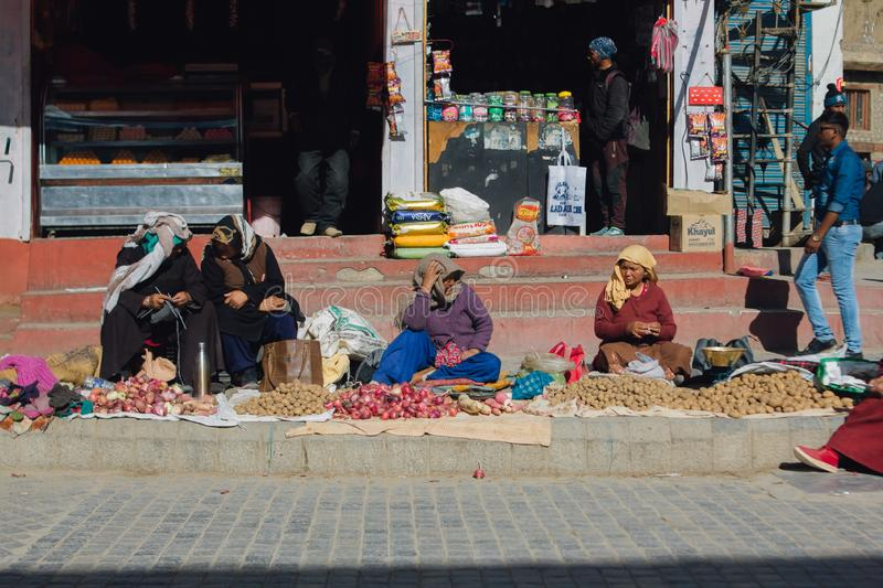 Tibetan market in Leh, Ladakh. Tibetan people selling fruit and vegetable on street market in Ladakh, Jammu and Kashmir, India. LEH, INDIA - April 19 2019 stock photo