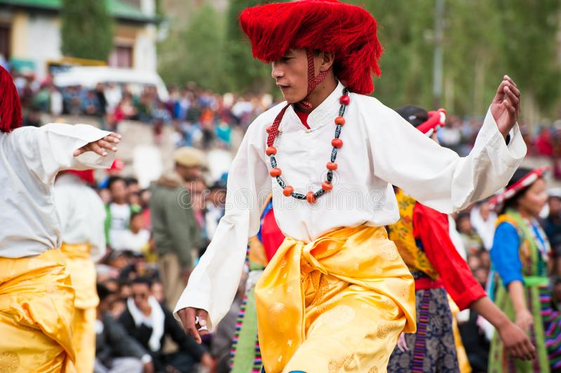 Young dancers in traditional Tibetan clothes performing folk dance.  Leh, Ladakh, India stock image