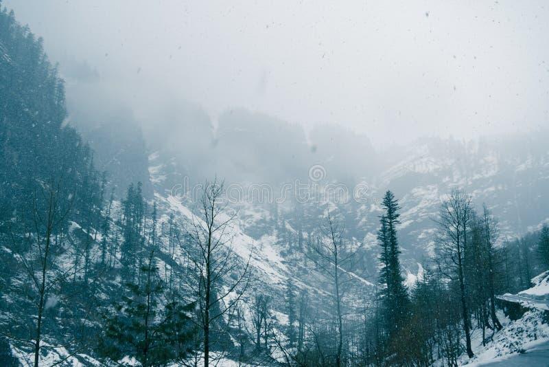 Leh Manali highway leading to Rohtang pass during snowfall. Snowfall near Manali on the way to Rohtang pass in Himachal Pradesh stock photo