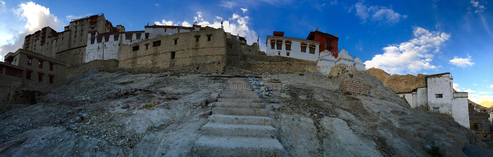 Leh palace - panoramic view from village below. Leh Palace is a former royal palace overlooking the Ladakhi Himalayan town of Leh. Modelled on the Potala Palace royalty free stock photography